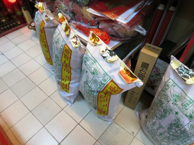Buddhists who don't have time to fold your own can simply buy from the stores by sack.