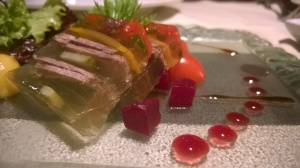 Beef and vegetable terrine with pumpkin seed oil