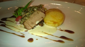 Oven roasted Australian lamb loin with macadamia nuts and olive crust, served on balsamic lentils and potato confit, ratatouille and celeriac cream sauce