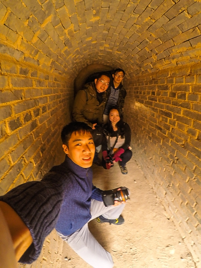 posing on the water passage out of the underground labyrinth