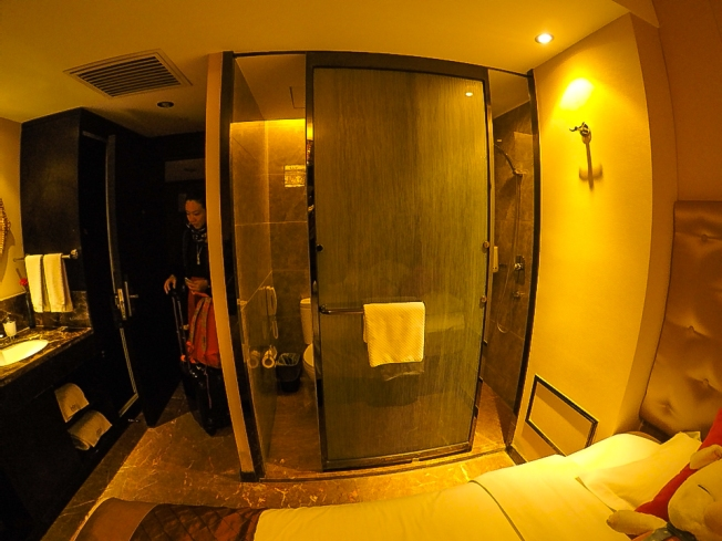 water closet and bath area sharing one sliding door in Mehood Hotel, Xian