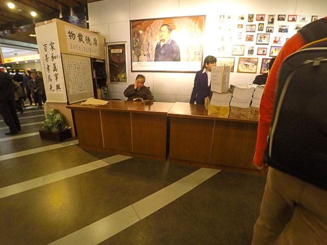 Stolen shot of the founder of this site. He was there, waiting for people to buy books, so he could sign them personally.