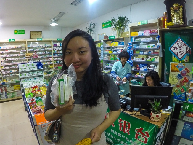 Buying Chinese medicine for my sore throat, cough and colds.