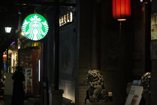 Modern Starbucks with an ancient facade, close to the end of the street.